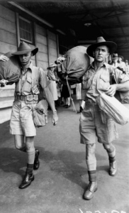 Soldiers wearing their shorts and carrying their kit bags  arriving at the railway station in Brisbane November 1941